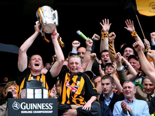 Kilkenny captain Henry Shefflin lifts the Liam McCarthy Cup with Darragh McGarry