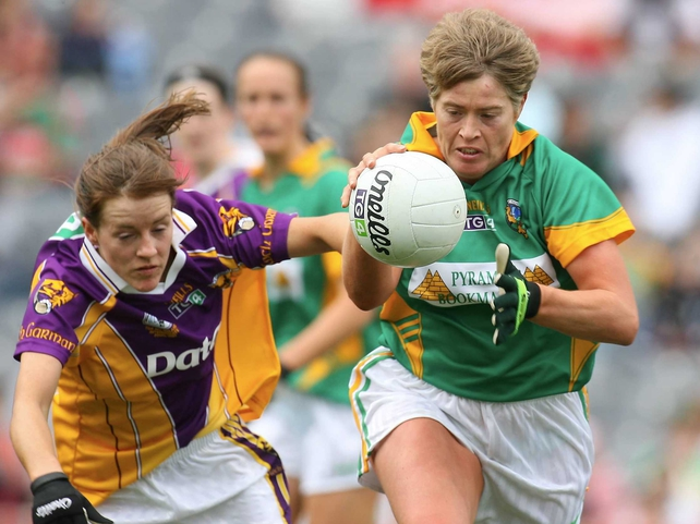 Maeve Quinn of Leitrim holds onto possession despite the efforts of Wexford's Kate Kelly