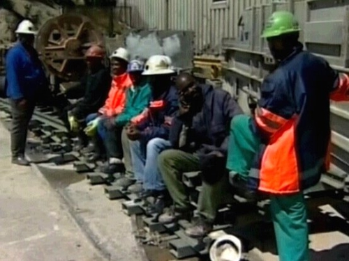 South Africa - Miners wait for colleagues to be rescued