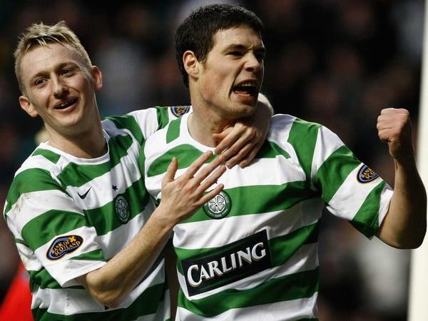 Darren O'Dea (r) celebrates a Celtic goal with Derek Riordan