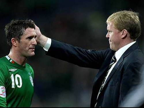 Steve Staunton consoles Robbie Keane after the game