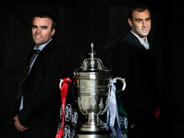 Longford Town Captain Damian Brennan and Cork City's Dan Murray alongside the Cup