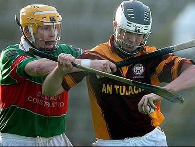 Tulla's Paul Lynch is pursued by Loughmore's Paul Ormond