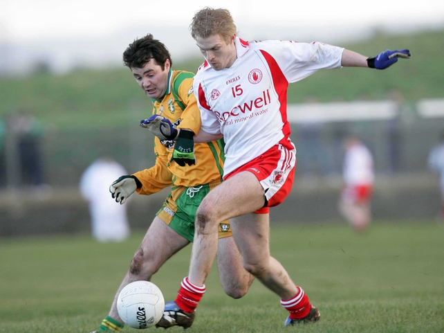 Tyrone's Sean O'Neill & Niall McCready of Donegal tussle for possesion