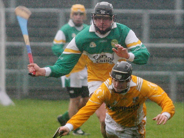 Offaly's Derek Molloy challenges Antrim's Sean Delargy