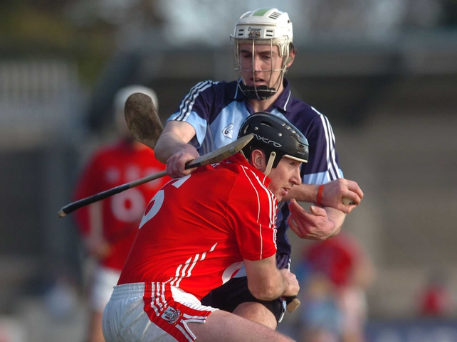 Cork's John Gardiner and Peter Kelly of Dublin get to grips with each other