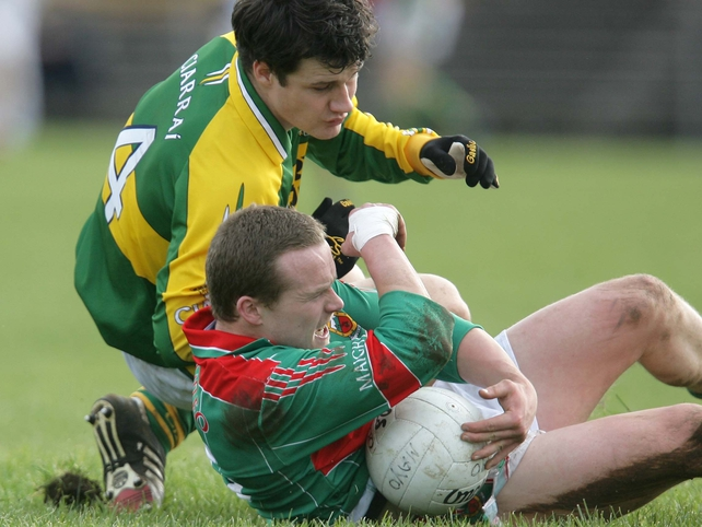 Mayo's Andy Moran gathers possession ahead of Padraig Reidy of Kerry