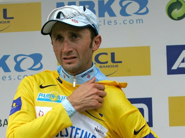 Davide Rebellin don's the leader's yellow jersey