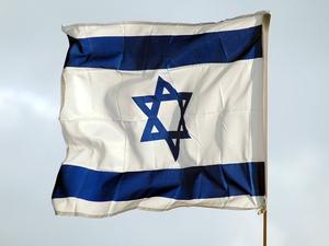 Israeli border police shot at a Palestinian holding a petrol bomb