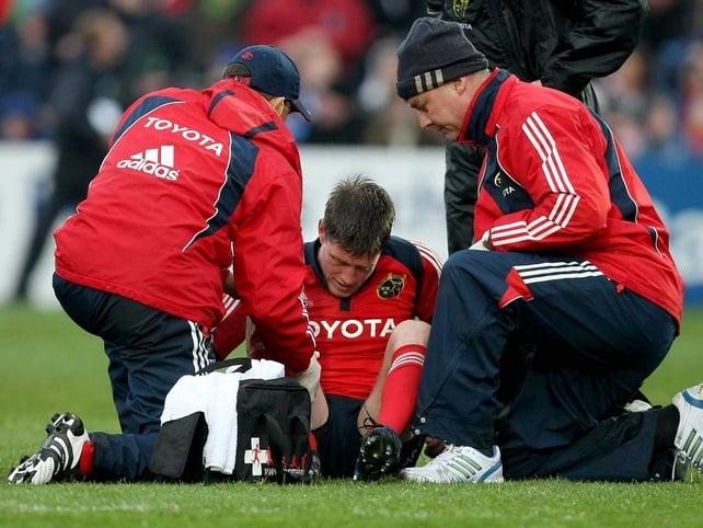 Ronan O'Gara receives medical attention before he was taken off
