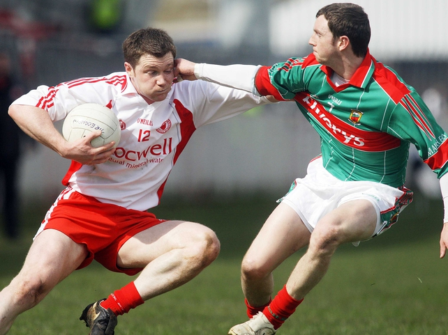 Enda McGinley tries to evade Mayo's Keith Higgins in Omagh this afternoon