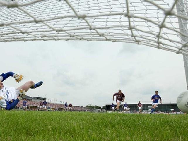 Mangan watches as his first half penalty sends Longford goalkeeper Damien Sheridan the wrong way