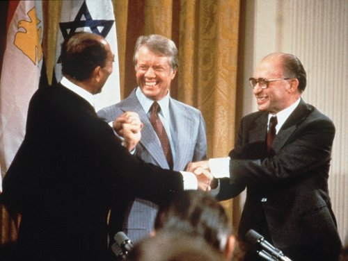 Nuclear Revelations - Former US President Jimmy Carter, seen here sealing a deal between Israel and Egypt in 1978, confirmed Israel's nuclear arsenal on Sunday