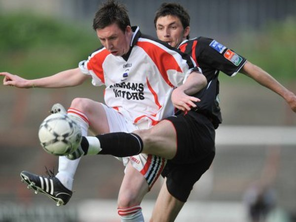 Brothers Sean and Killian Brennan tussle for the ball