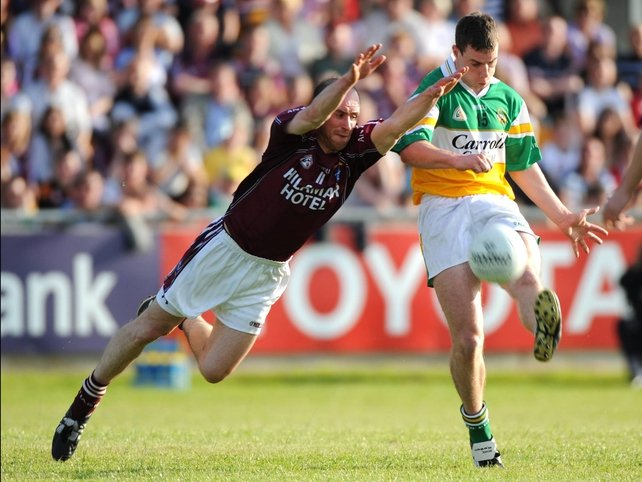 Offaly's Niall McNamee is challenged by John Smyth