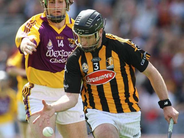 Kilkenny's JJ Delaney in action against Wexford's Stephen Banville