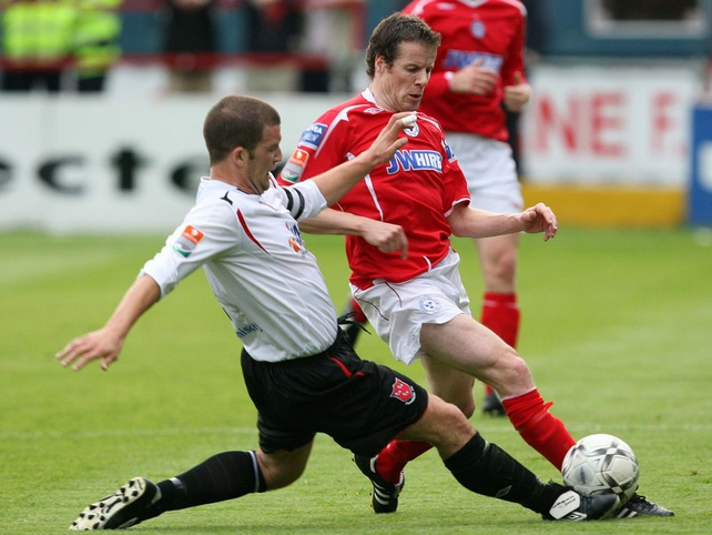 Shelbourne's James Keddy is tackled by John Flanagan of Dundalk