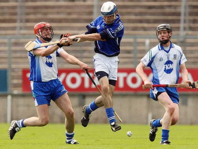 Cavan's Andrew Nelligan is surrounded by Monaghan's Michael Greaney and Stephen Lambe