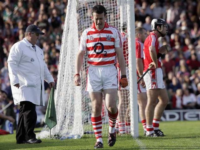 Dónal Óg Cusack walks to the dressing room after his first half dismissal