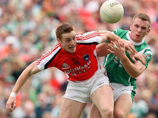 Armagh's Charlie Vernon and Fermanagh's Martin McGrath tussle during an absorbing Ulster SFC final in Clones