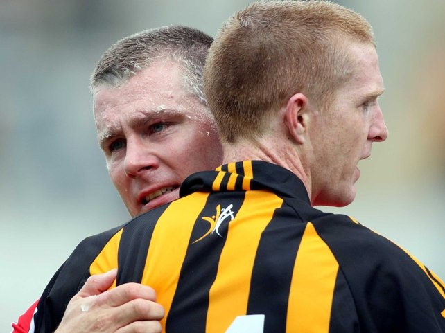 Cork's Diarmuid O'Sullivan and Henry Shefflin of Kilkenny embrace at the end of the game