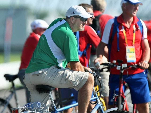 Lightweight four coach John Holland watches his charges in action in Beijing