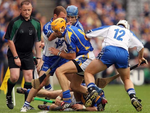 Tipperary's James Woodlock & Conor O'Brien and Waterford's Eoin McGrath & Stephen Molumphy battle for possession