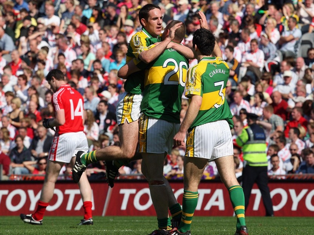 Declan O'Sullivan, Michael Quirke and Tom O'Sullivan celebrate at the final whistle
