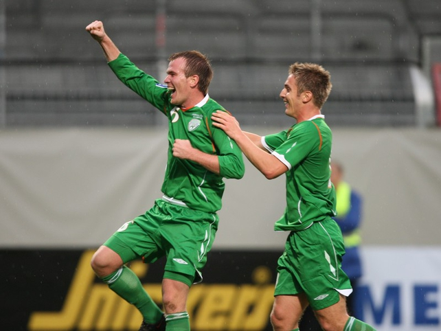 Glenn Whelan celebrates his first goal for Ireland with fellow goalscorer Kevin Doyle
