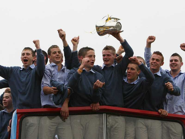 Members of the successful senior and minor Kilkenny teams parade their wares from the top of the open-top bus