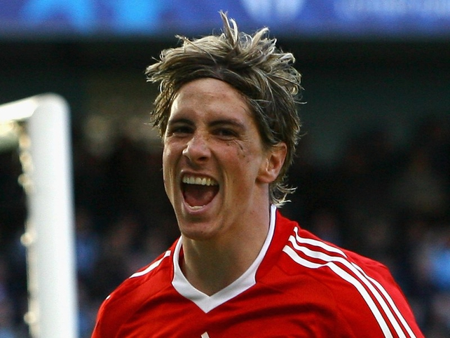 Fernando Torres scored for the Reds against their bitter rivals