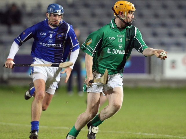 Munster's Tom Kenny and Richie Power of Leinster in action in Portlaoise this evening