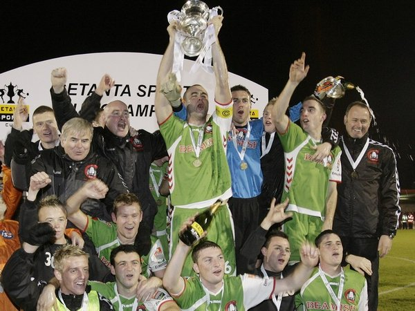 Cork City's players and staff celebrate their Setanta Sports Cup success