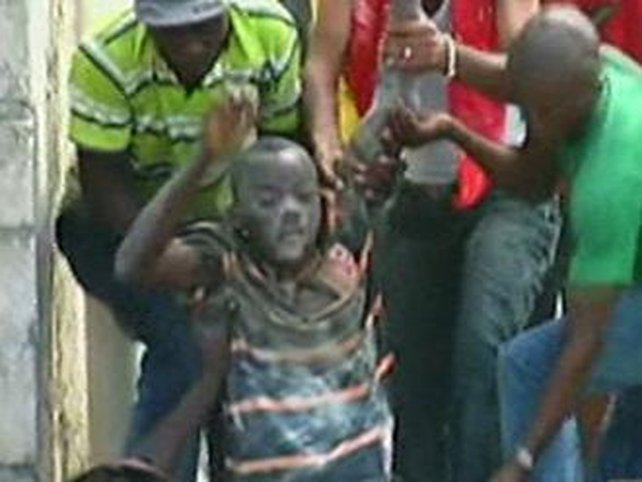 Haiti - Young boy is rescued