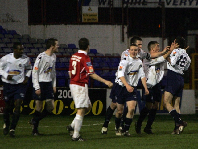 Colin Scanlon is congratulated by his team-mates after scoring the equaliser