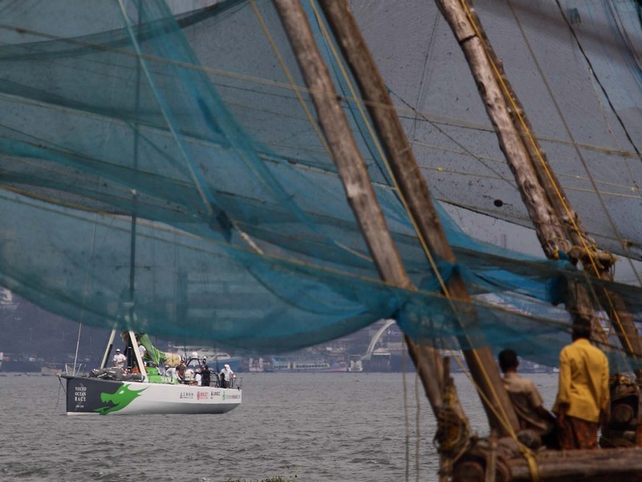 The Green Dragon leaves Cochin under the watchful eye of local fishermen