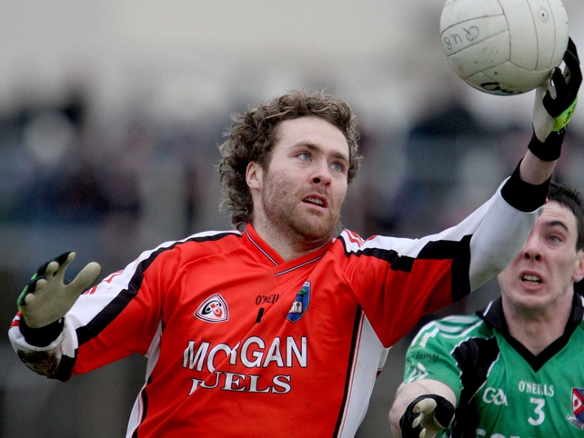 Ryan Henderson's goals proved crucial as Armagh defeated Queen's