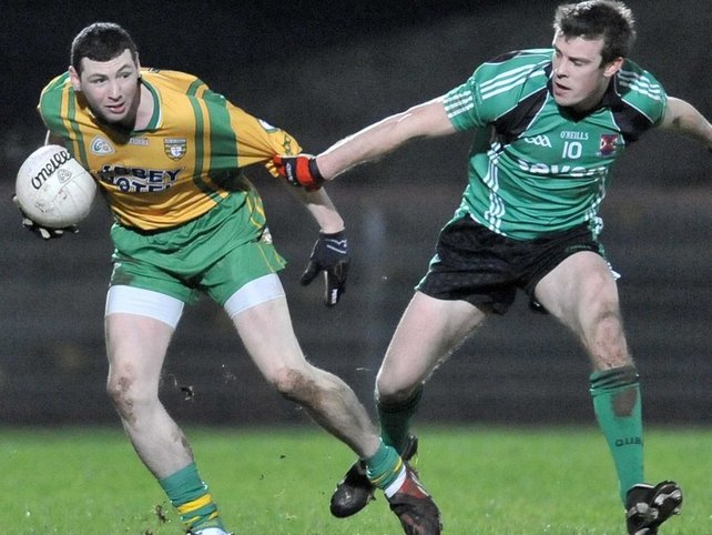 Donegal's Ciaran Bonner and James Loughrey of QUB in action at Healy Park