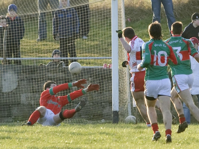 James Kielt slots the ball past Mayo goalkeeper David Clarke to score the only goal