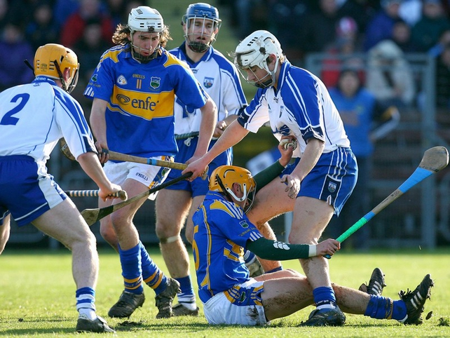 Waterford's Richie Foley and Willie Ryan of Tipperary tussle for possession at Walsh Park