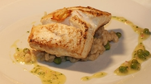 Fillet of Pan Fried Halibut served with a Creamy Pea Risotto
