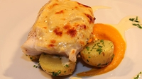 Baked Gratin of Hake with mature cheddar, mustard and cream - A great way to serve hake.