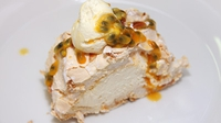 Passion Fruit and Lemon Meringue Roulade Served with Passion Fruit Sauce - You won't want to share this with your guests!