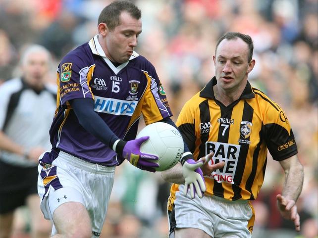 Kilmacud's Pat Burke is challenged by Crossmaglen's John Donaldson