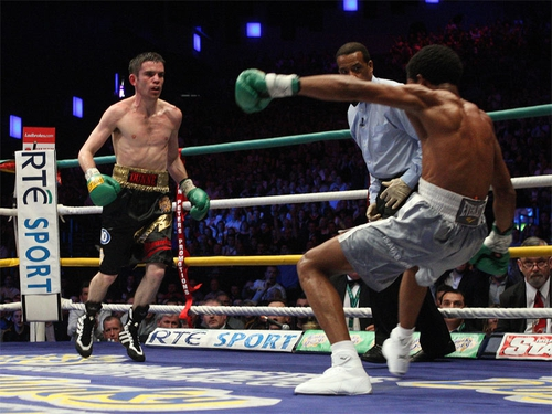 Bernard Dunne knocked the champion down three times in the eleventh round before the referee called a halt to the fight one second before the bell