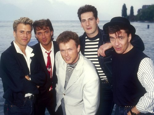The group pictured back in the 1980s