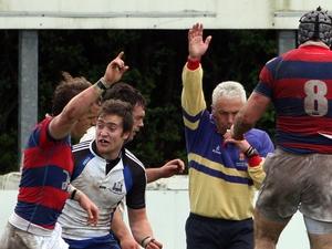 Alan Lewis signals Heinrich Stride's first try