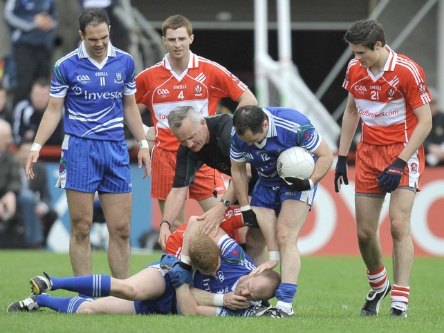 Derry's Fergal Doherty tussles with Monaghan's Dick Clerkin