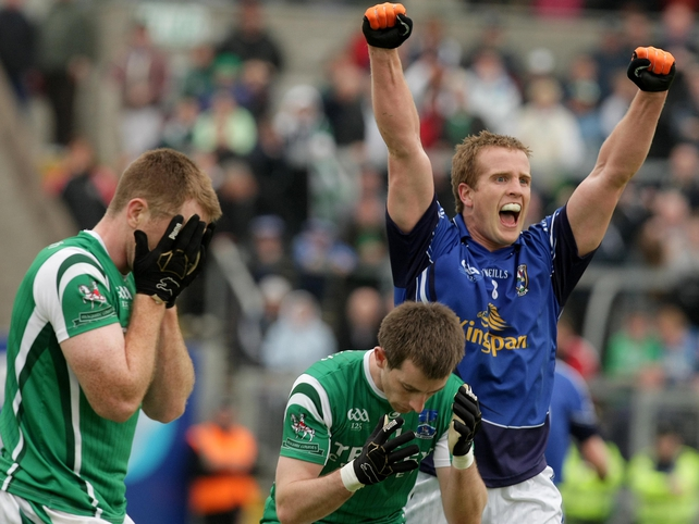 Cavan's Nicholas Walsh celebrates at the final whistle as the Fermanagh players feel the pain of defeat