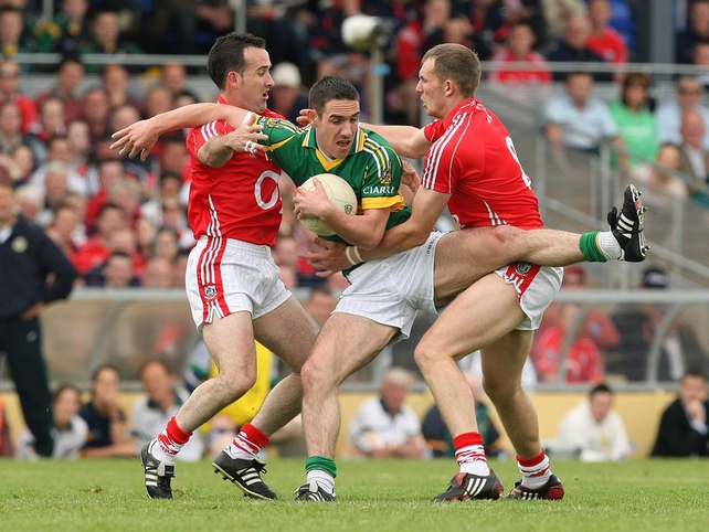 Cork's Kieran O'Connor and Alan O'Connor put Kerry's Declan O'Sullivan under serious pressure